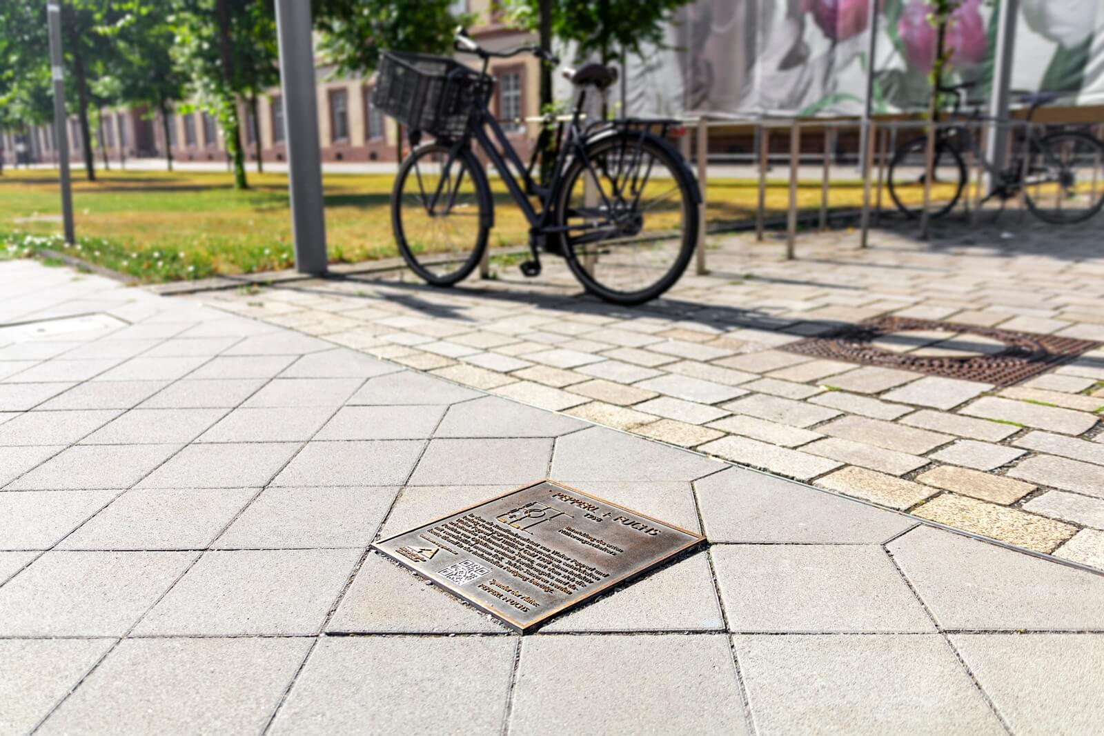 Pepperl+Fuchs' bronze plaque on the Electoral Palatinate Mile of Innovations in Mannheim, Germany